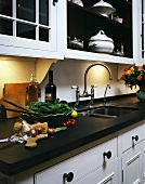 Food preparation on work surface of country house style kitchen counter