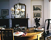 Set table in traditional dining room with fireplace