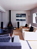 Elegant designer living room with light seating in front of open fireplace