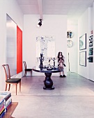 Modern pictures and works of art around table in anteroom