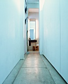 Simple, narrow corridor with concrete floor