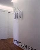Stainless steel, suspended works of art in hallway