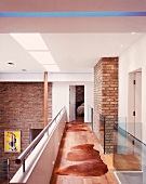 Gallery in contemporary house with brick walls