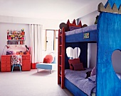 Bunk beds with blue-painted wooden frame in children's bedroom