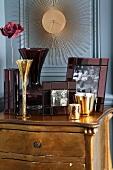 Picture frames, vases & tea light holders on chest of drawers