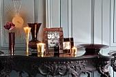 Vases, picture frames & tea light holders on table