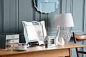 Table lamp & ornaments on side table