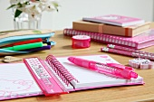 Pink writing materials on child's desk