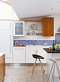 White kitchen with island & bar stools