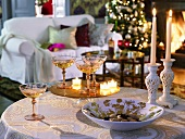 Christmas atmosphere with candles on festive side table