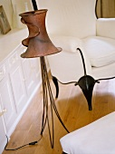 Handcrafted standard lamp made from metal wire with curled lampshade