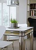 Small dining area in cool black and white with designer furniture and retro lamp