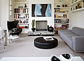 Contemporary, designer living room with 60s wingback armchair in reading corner