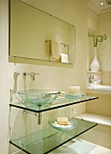Modern, cream bathroom in classic setting with glass washstand and basin