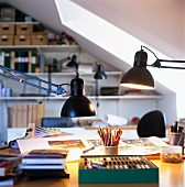 Retro desk lamps illuminating desk