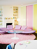 Designer couch with pink leather upholstery in a living room