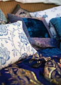Pillows with white and blue covers and floral pattern