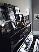 Framed pictures on a piano