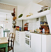 White kitchen counter with brick extractor fan