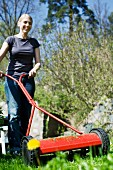 Lady mowing the lawn
