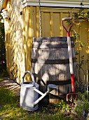 Tool shed with rain barrel, watering can and pitchfork