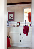 View into bathroom with white base unit