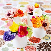 Colorful bouquets on a table cloth with a floral pattern