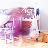 Child's bed with old metal frame