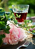 A peony and a glass of red wine