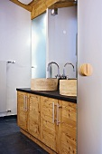 Modern bathroom with stone basins on wooden washstands