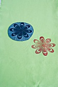 Linoleum template with floral motif and coloured print on fabric