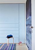 Bauhaus stool in front of designer fitted wardrobe