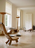 Rustic, sculptural pieces of wooden furniture in minimalist room