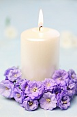 Candle with circlet of campanula flowers