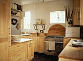 Kitchen with solid wood fronts and L-shaped kitchen unit