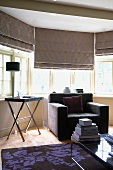 Elegant grey furnishings - armchair and half-closed blind in bay window
