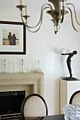 Art Nouveau table lamp on pedestal next to open fire