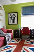 Rug with Union Jack motif in front of desk and window in teenager's bedroom