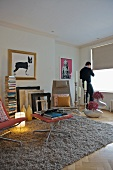 Fifties-style stool on flokati rug in modern living room