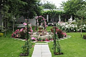 Lovingly tended rose garden with archway, fountain and lawn