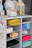 Colorful hand towels in a half-high bookcase