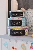 Canisters with writing on them on a painted chest of drawers