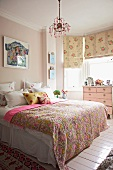 Romantic bedroom with patterned throw on bed