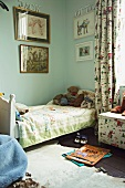 Corner of traditional child's bedroom with soft toys on bed