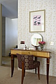 Upholstered chair with elegant silk cover and Biedermeier-style console table