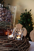 Christmas decor with large fir cone and tea lights