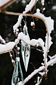 Glass Christmas decorations hanging from twig