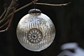 Silver Christmas bauble on branch