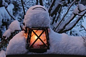 Lantern with a cap of snow
