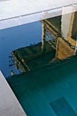Infinity pool with reflections on water's surface